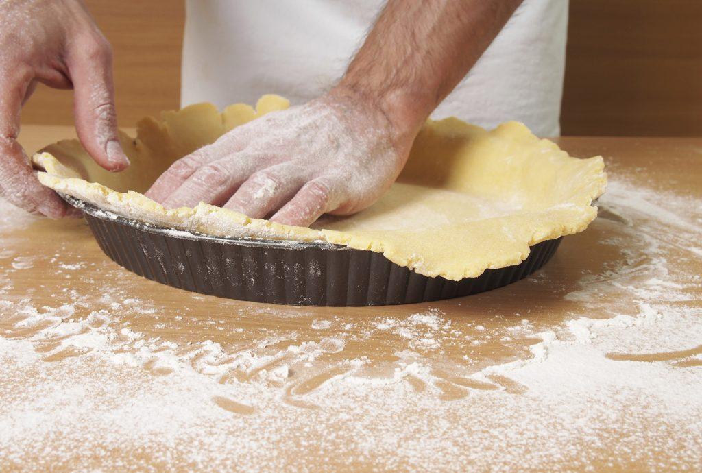 chef making an apple pie