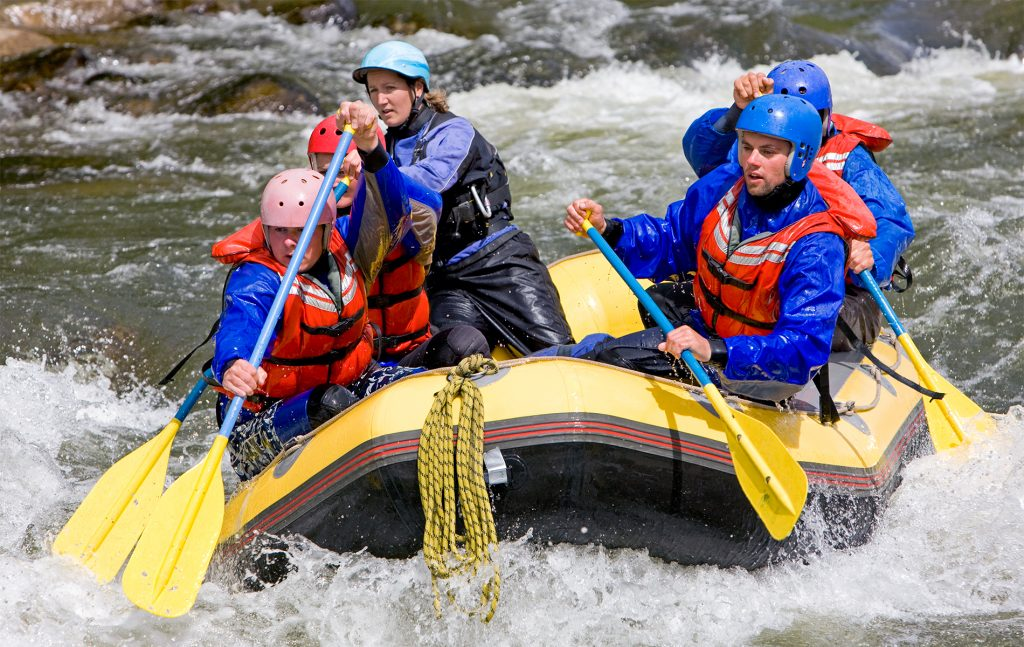 rafting on avisio river in the dolomites